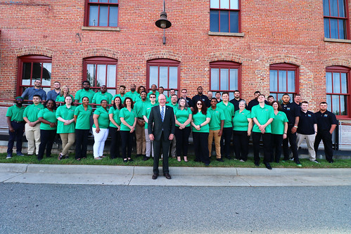 Virginia's Secretary of Commerce & Trade, the Honorable Brian Ball, stands with SVHEC's largest group of job training program completers.