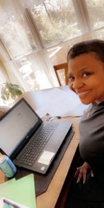 Virginia Byrd working from home on a laptop computer