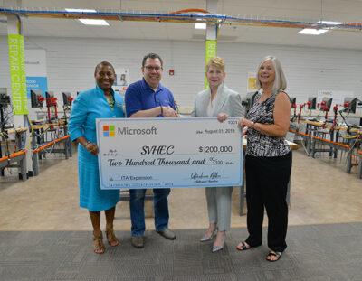 Microsoft Corp representative presents a check to SVHEC staff